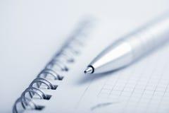 Macro del taccuino e della penna Fotografia Stock