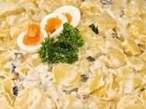 Party potato salad with egg. Macro of delicious potato salad stock photography