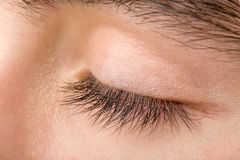 Macro dell'occhio dell'uomo dell'adolescente Immagine Stock