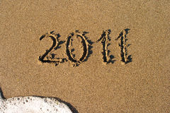 Macro della spiaggia della sabbia con il numero 2011 Fotografia Stock Libera da Diritti