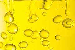 Macro delle gocce dell'olio fotografia stock