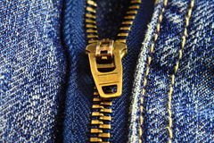 Macro of a denim zipper. Macro of a zipper on a pair of denim jeans background texture Stock Images