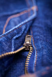 Macro Detail of a blue jeans zipper Stock Image