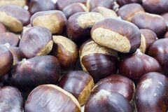 Detail of chestnuts stacked and stacked in the foreground nuts royalty free stock photo