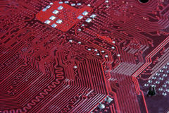 Macro detail computer motherboard hardware in red Royalty Free Stock Photos