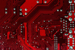 Macro detail computer motherboard hardware in red Royalty Free Stock Photography