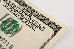 Macro detail of a 100 dollar bill. With white background Stock Images
