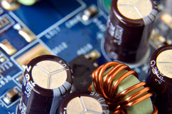 Macro detail of electronic capacitators. And coil Royalty Free Stock Photos