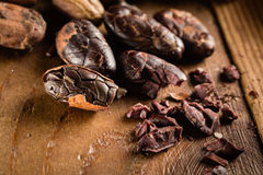 Macro detail of grunge cocoa beans. On the wooden table or desk in the kitchen stock photo