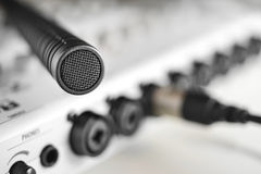 Macro detail of a high fidelity condenser microphone. Macro detail of top condenser microphone over sound mixer.(Macro details Royalty Free Stock Photos