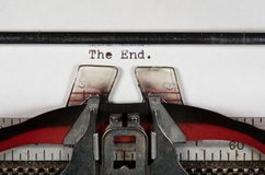 Macro detail of The End on electric typewriter with ribbon Royalty Free Stock Images
