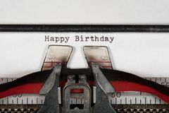 Macro detail of Happy Birthday on electric typewriter with ribbon Royalty Free Stock Photo