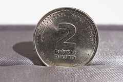 Macro detail of a metal coin of two Shekels (Israeli currency New Shekel, ILS) Stock Images