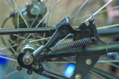 Macro detail of a metal hub of a bike with blue forks. Demounted Royalty Free Stock Photography
