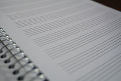 Macro detail of a notepad with paper lined as piano sheet with lines prepared for composing music Royalty Free Stock Photos