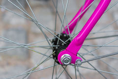 Macro detail of a purple fork on a fixie bike Royalty Free Stock Images
