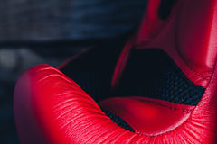 Macro detail of red boxing gloves. Stock Image