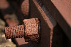 Macro detail of rusty train rail. Macro detail of rusty bolt of train rail sleeper lack of maintenance and time action stock photography