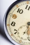 Old scuffed pocket watch macro detail Royalty Free Stock Photo