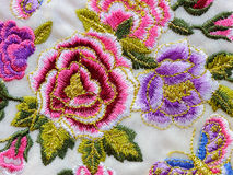 Macro detail silk embroidery flowers Stock Photos