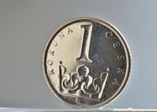 Macro detail of a silver coin in value of one Czech Crown Kc, CZK on white and silver background as a symbol of Czech currency. Macro detail of silver coin in Royalty Free Stock Photos