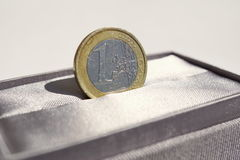 Macro detail of a silver and gold Euro coin placed in the gray luxurious jewelry gift box Stock Images
