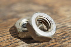Macro detail of a siver metal small nut (Replacement nut) Royalty Free Stock Photo