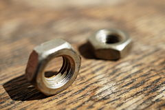 Macro detail of a siver metal small nut (Replacement nut) Royalty Free Stock Image