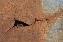 Torn rusty metal texture. Macro detail of torn rusty metal texture royalty free stock photo