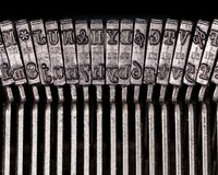 Macro detail of typescript inside electric typewriter. Detail of the individual hammers with engraved text and typescript inside electric typewriter Stock Images