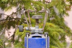 Old camping gas cooker. Macro detail of used dirty gas cooker used for camping royalty free stock photo