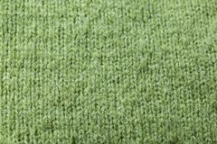 Knitted green wool fabric close-up stock image