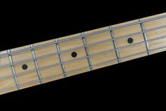 Bass Guitar Ftreboard and Strings Macro Detail Stock Images
