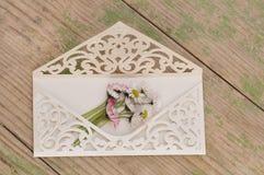 Wedding invitation with flowers. Macro detail of wedding invitation with daisies flower Stock Image