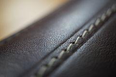 Macro detail of a white thread stitching black and brown stitched leather wallet Stock Photography