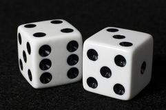 Macro dice on black felt Royalty Free Stock Photos