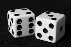 Macro dice on black felt Royalty Free Stock Photos