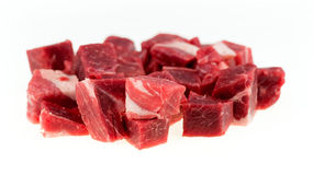Macro of diced chunks of raw lamb and mutton meat isolated on white. Closeup macro of marbeled, uncooked lamb and mutton isolated against a white background Stock Image