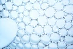 Macro dichte omhooggaand van zeepbels Stock Fotografie