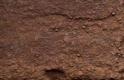 Macro die textuur van bruine kleimuur schieten royalty-vrije stock afbeeldingen