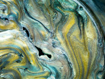 Glossy pearlescent pigments mixed with oil, detail. Macro of different colored pearlescent pigments mixed with oil Royalty Free Stock Photos