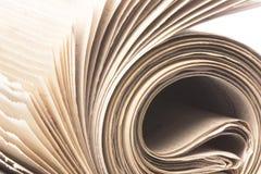 Macro do rolo do jornal isolado Imagem de Stock