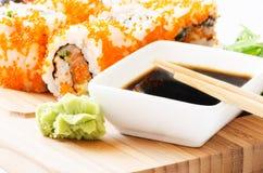 Macro do sushi e da soja Imagens de Stock Royalty Free