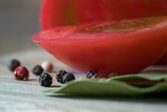 Macro do tomate com pimenta Foto de Stock