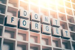 Macro Of A Don`t Forget Reminder Formed By Wooden Blocks In A Typecase royalty free stock photos
