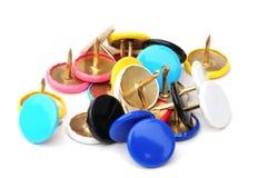 Macro of drawing pins. Close up shot of some thumb tacks on white Stock Photo