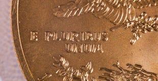 Macro of E Pluribus Unum. Gold Eagle one ounce coins with macro shot of the engraving of E Pluribus Unum stock images