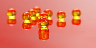 Macro of E vitamine pills on red Royalty Free Stock Image