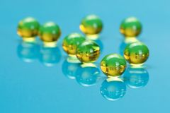 Macro of E vitamines on blue Stock Photography
