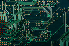Macro of electronic circuit board pcb in green stock photo